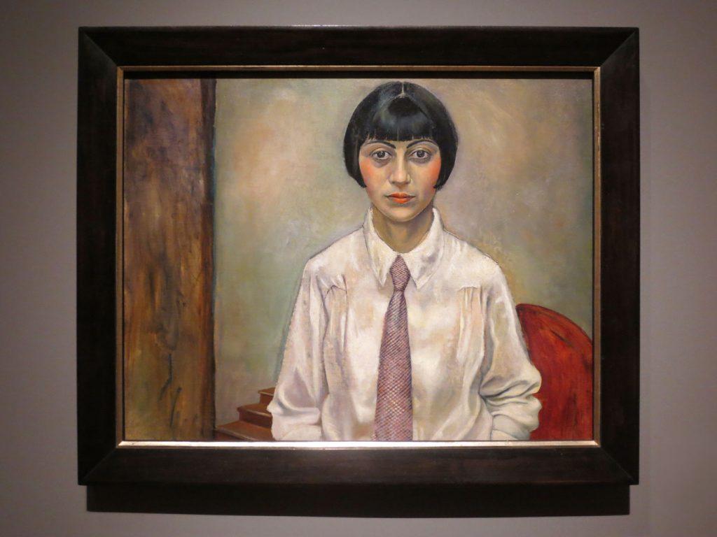Glanz und Elend in der Weimarer Republik, Rudolf Schlichter, Porträt einer Frau mit Pagenschnitt und Krawatte, 1923